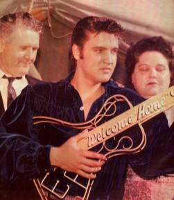 Elvis Presley picture with guitar and his parents
