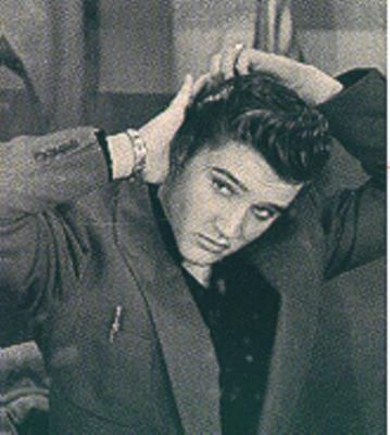 Elvis Presley pictures combing his hair