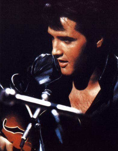 Elvis Presley pictures head shot dressed in black leather