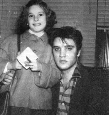 Elvis Presley picture with a young girl fan